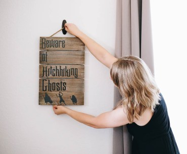 DIY Disney Inspired Haunted Mansion Beware of Hitchhiking Ghosts Halloween Sign