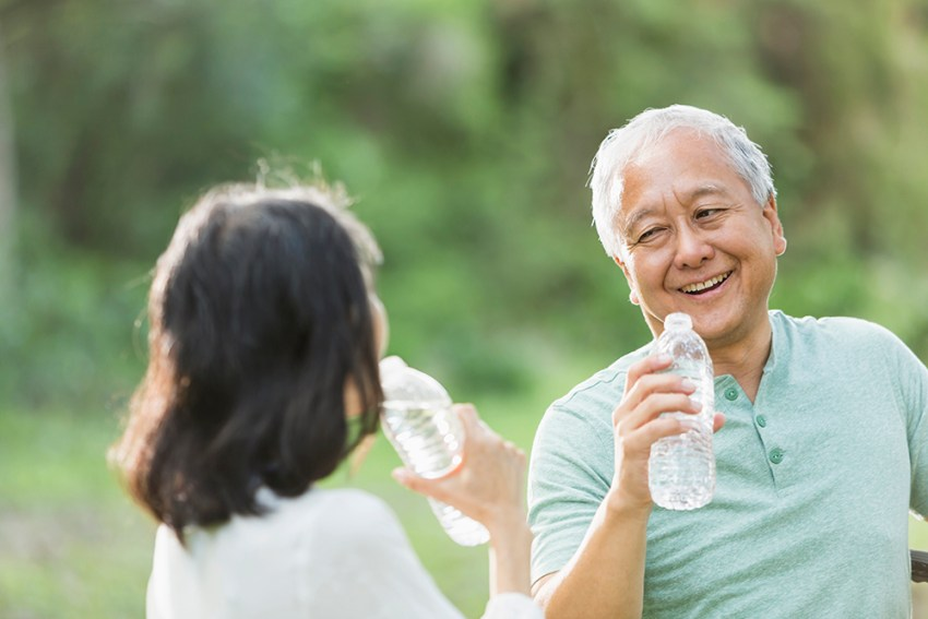 AHF-Blog-Senior-Couple-Drinking-Water-Outdoors