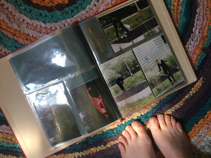 The photo album is open on my rag rug and you can see my toes.