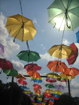 why not have a path covered in colorful umbrellas?