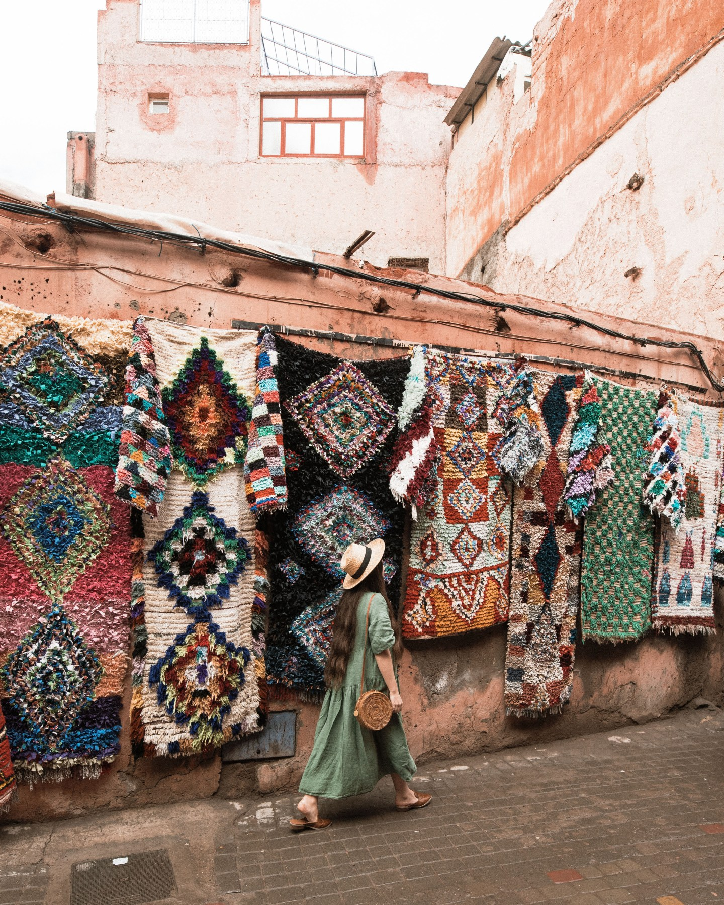 Colorful carpets lining the walls of the Souks in Marrakech