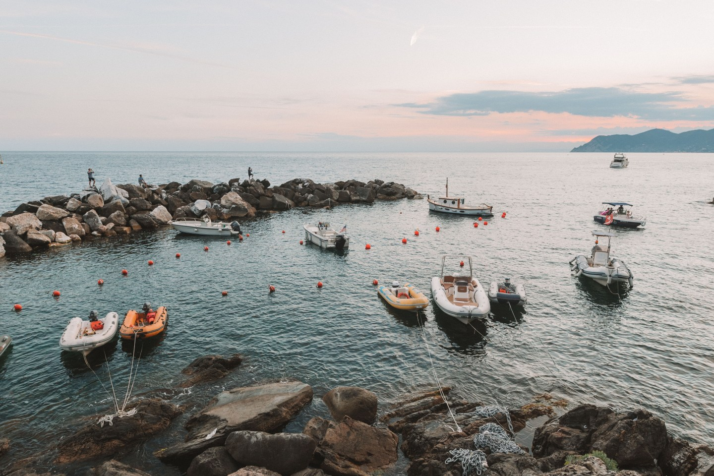 Boats in the harbour at sunset in Riomaggiore