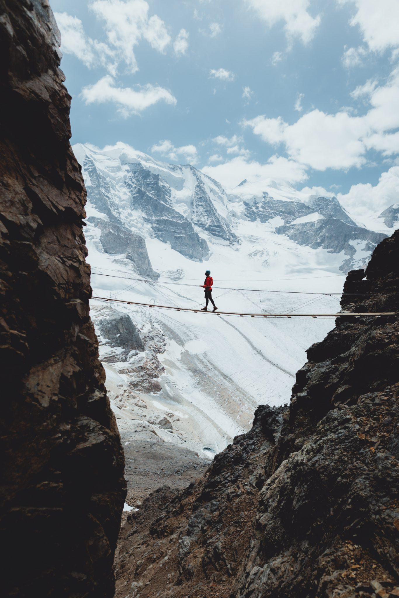 Climber crossing a rope bridge