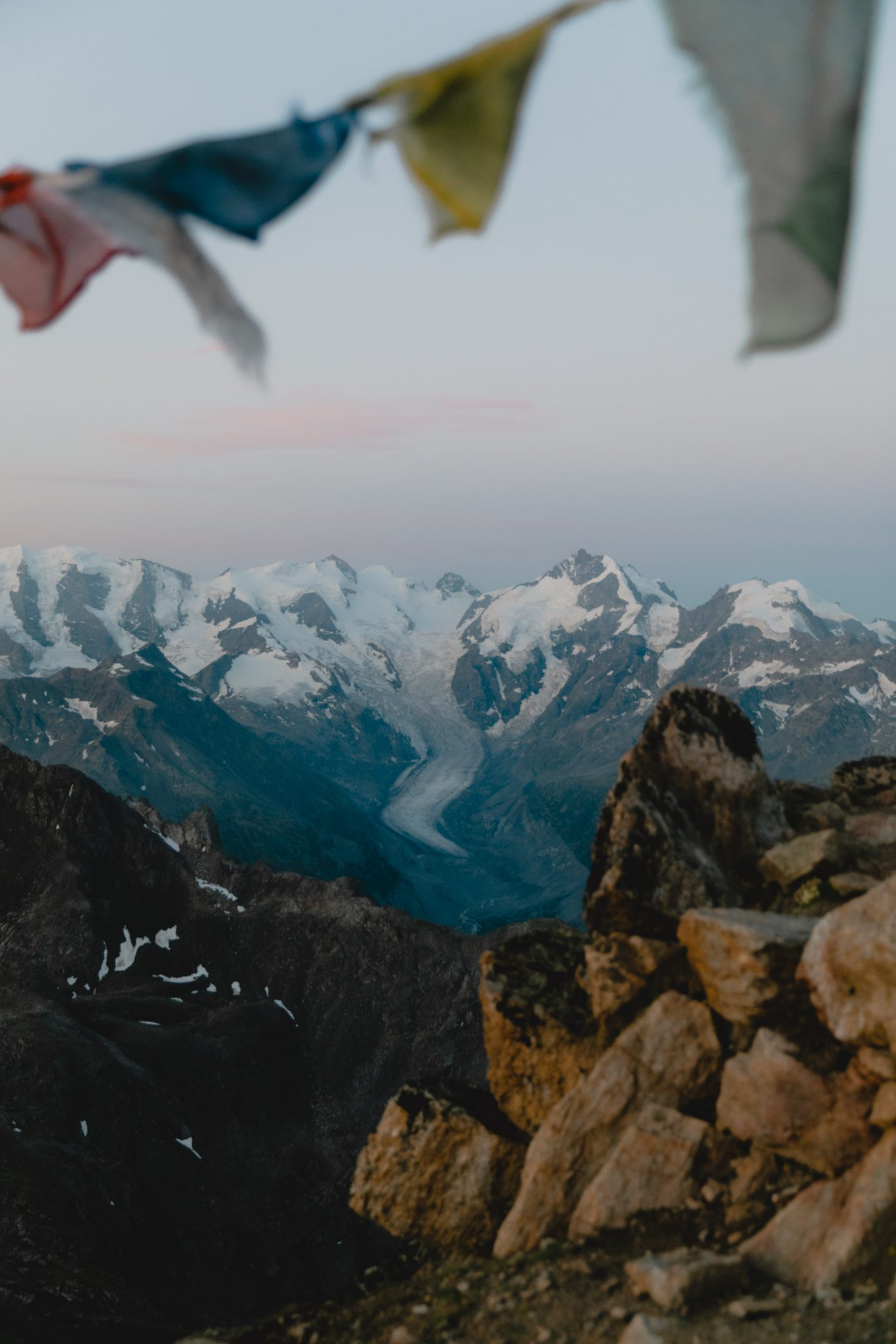 Mountains with glacier and flags in the foreground