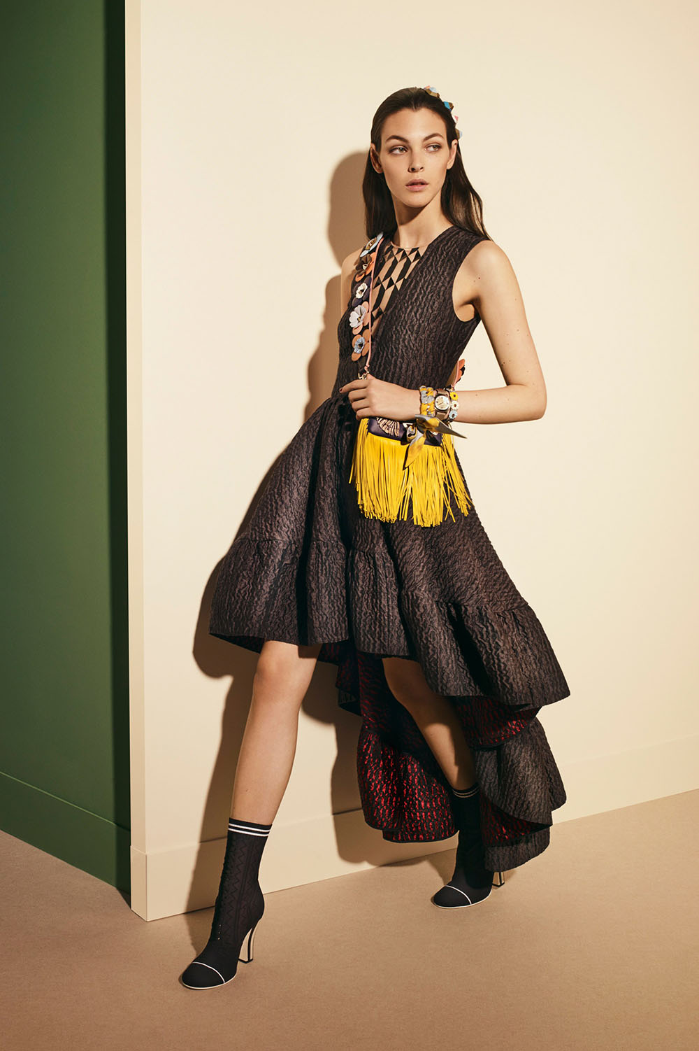 Ruffles, lace and bows all find a home in Fendi's offering for pre-fall 2017. With a decidedly feminine and romantic tone this collection is an opulent homage to decretive embellishment. Certainly less stark then what we have seen from the brand in the past. It embraces the idea of decadence but in a manner that is wholly approachable and moder