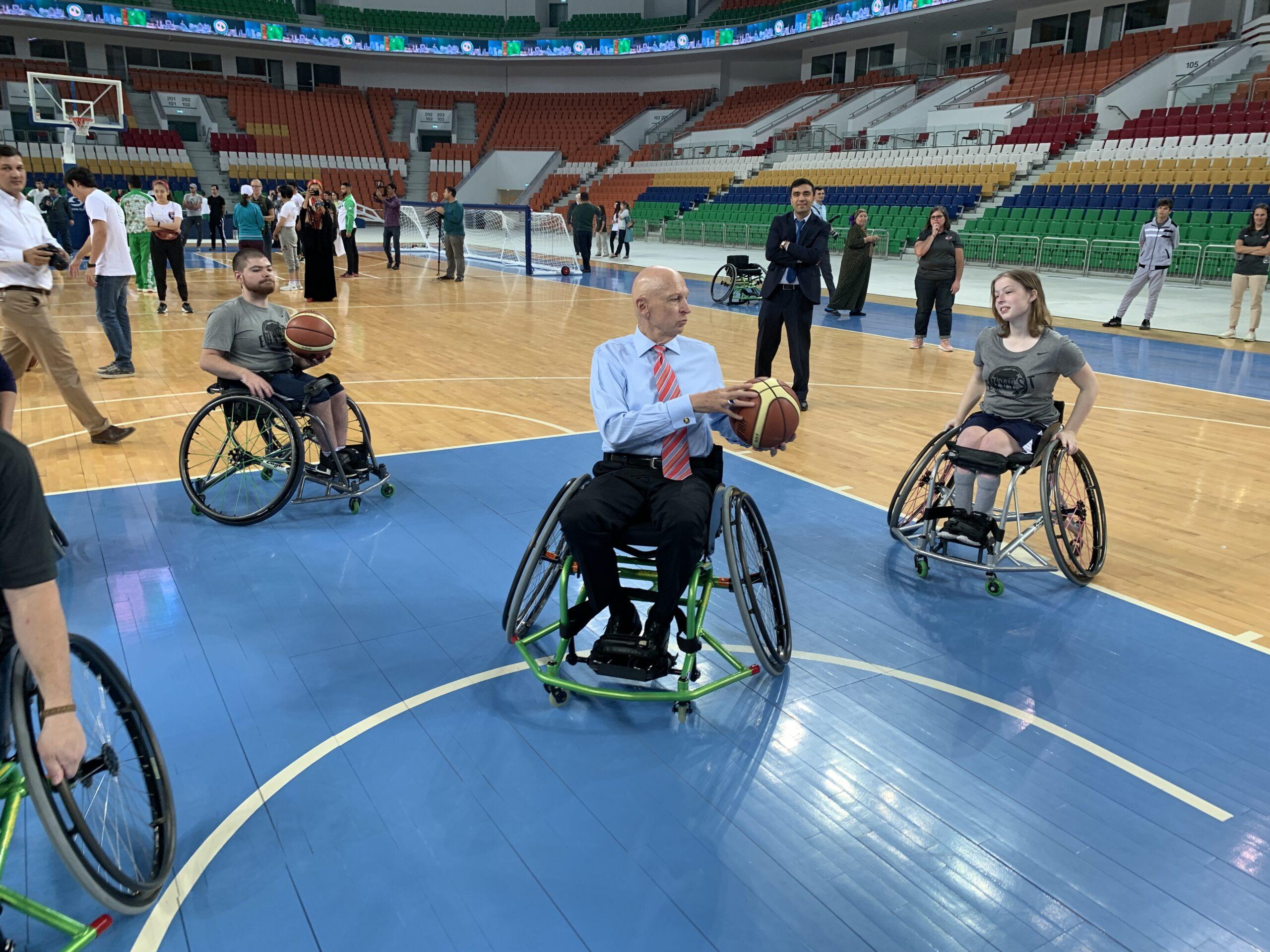 Ambassador playing wheelchair basketball