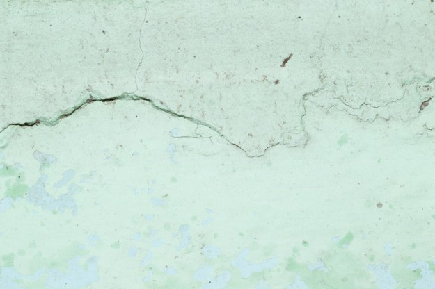 abstract background of old cracked green wall