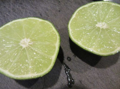 One lime, to be juiced into a bowl.
