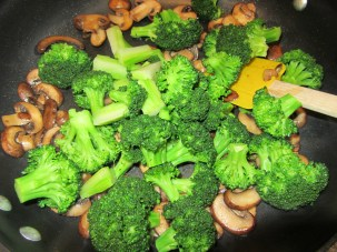 Broccoli added to mushrooms.