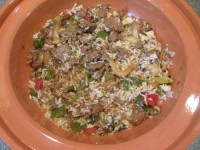 Leftover Chinese beef and rice in terra cotta dish.