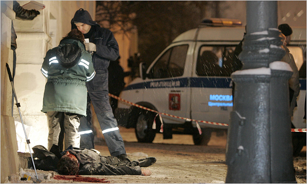 Investigators standing over the body of the lawyer Stanislav Markelov in Moscow on Monday. He and Anastasia Baburova, a freelance journalist, were killed after he held a news conference. (Mikhail Voskresensky/Reuters)
