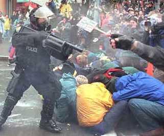 policeman_shooting_plastic_bullets_at_demonstrators_in_eattle