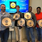Locums employees accept their record awards at the quarterly meeting