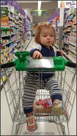 Toddler sitting in Woolworths trolley wearing Toddler wearing The Sleepy Company X-TEND Sleepsuit