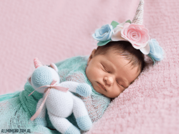 newborn baby professional photo with unicorn headband