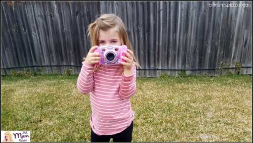 girl playing with Vtech toys kidizoom duo camera