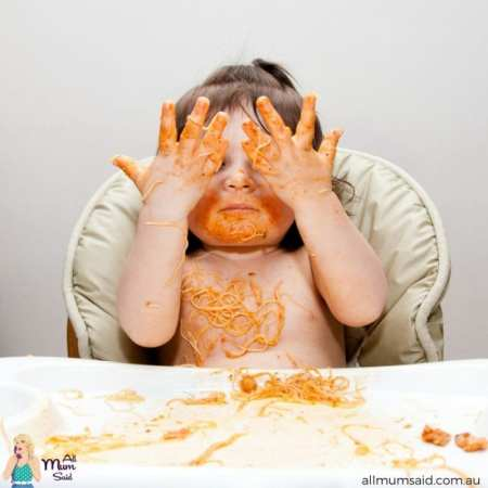 Toddler eating messy spaghetti