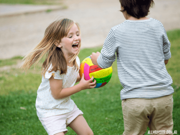 teaching kids social skills through sport | boy and girl laughing and playing