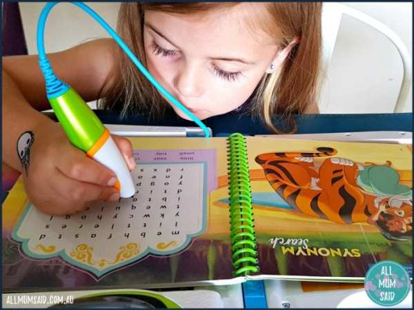 girl playing with LeapStart 3D Disney Princess book