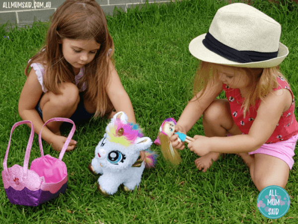 Girls playing with BFF collectables outside