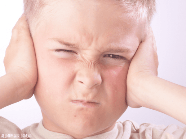 boy frustrated covering ears