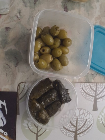 Olives and dolmades from local market into my own containers