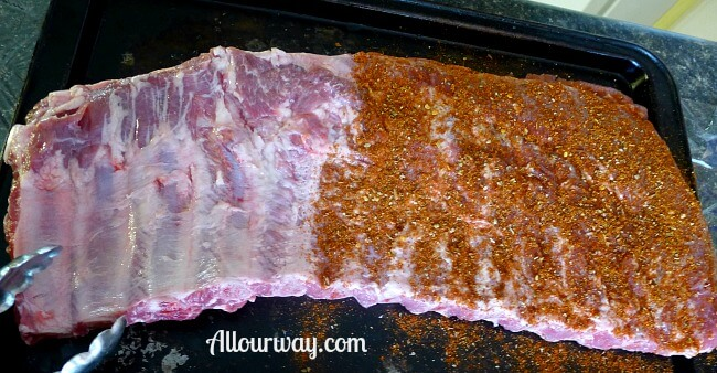 Smoked Pork Ribs Adding All Our Way Rub at Allourway.com