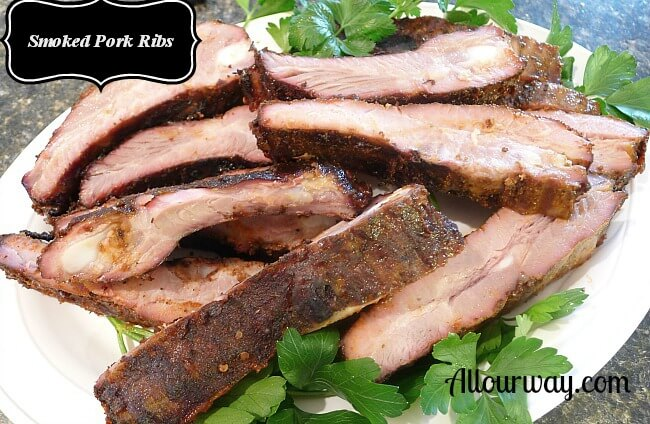 Smoked Pork Ribs finished with bark and a smoke ring at allourway.com