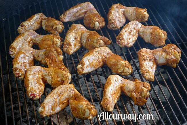 Chicken wings on the grill with the outer side down.