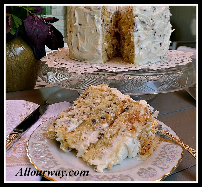 Italian Cream Cake with Toasted Coconut sliced at allourway.com