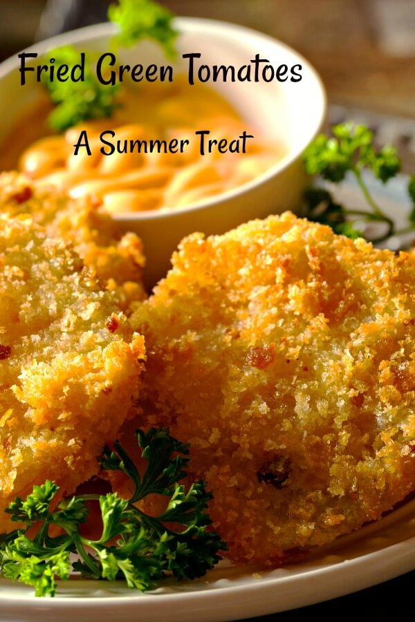 fried green tomatoes with green parsley and creamy dipping sauce in background.