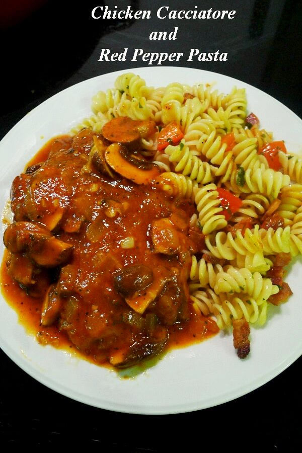 Chicken Cacciatore with red sauce and rotini pasta on a white dish