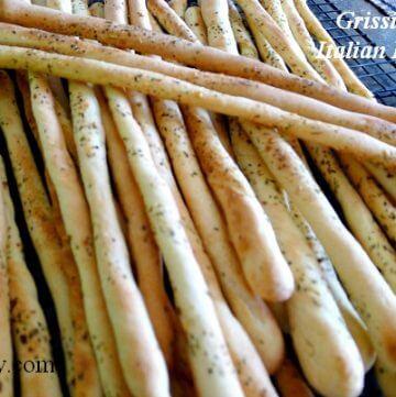 Grissini - crunchy Italian breadsticks cooling on rack @allourway.com