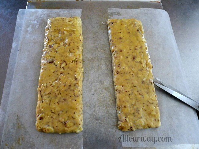 Biscotti dough is formed on kitchen parchement and cut into two long rectangles @allourway.com