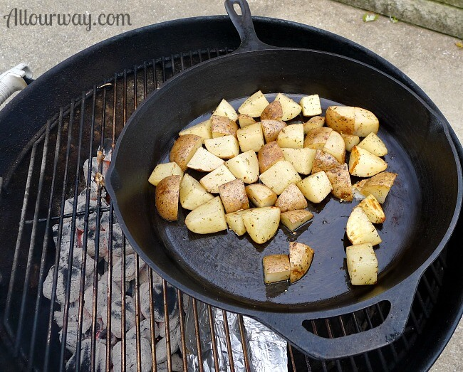 Cast iron skillet is placed on the chicken now over indirect heat @allourway.com