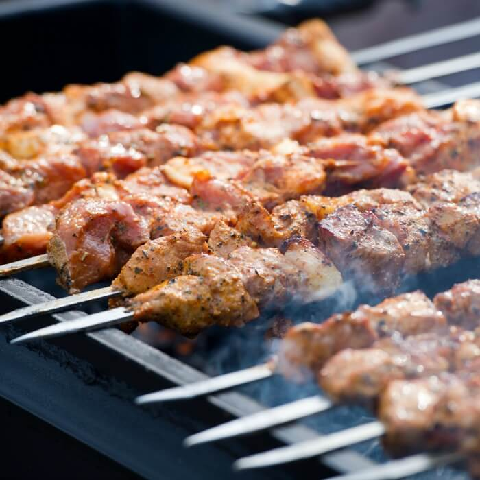 Grilled Pork Kebabs on Skewers over a hot grill.