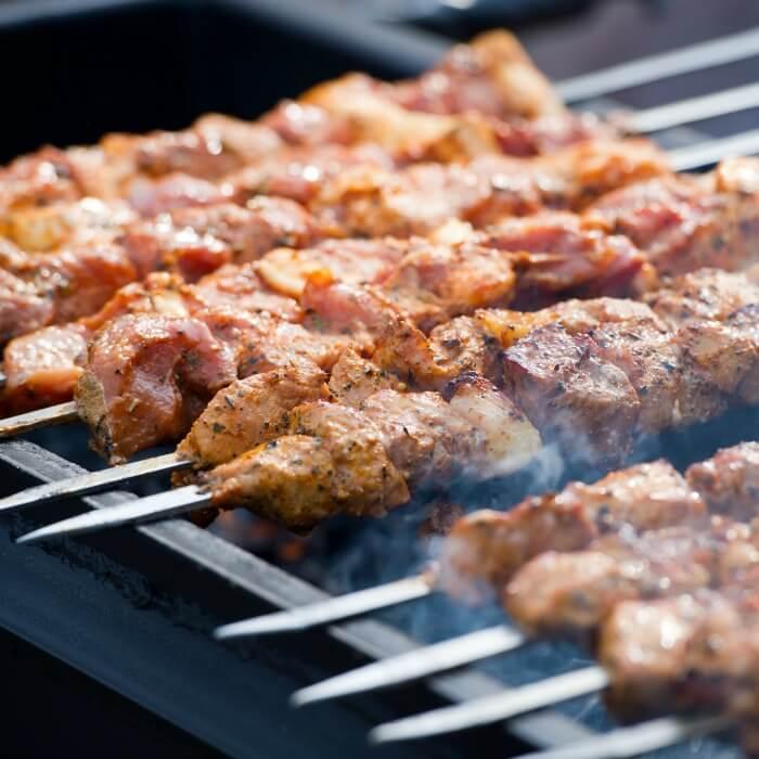 Grilled Pork Kebabs on Skewers over a hot grill.