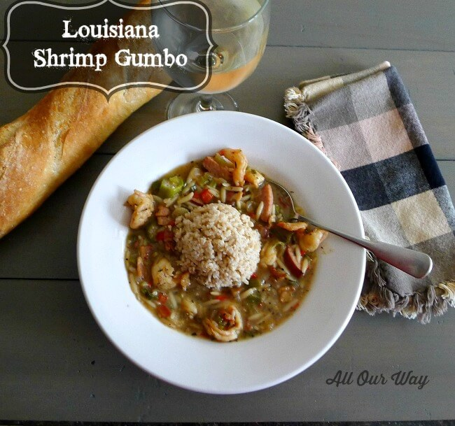 Louisiana Shrimp Gumbo with Brown Rice in bowl with bread and glass of wine.