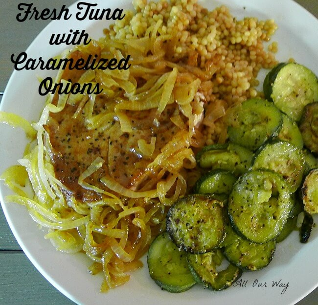 Fresh tuna with caramelized onions with sides of couscous and zucchini medallions @allourway.com