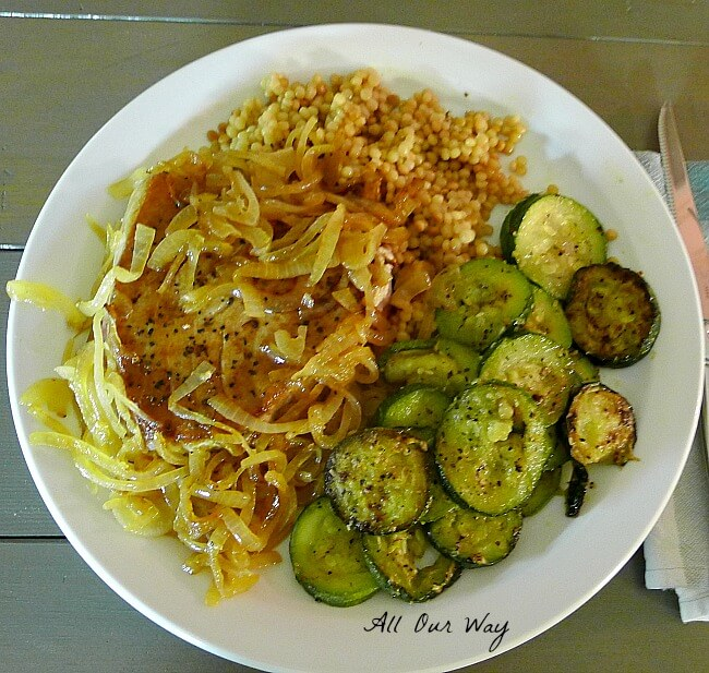 Fresh tuna with caramelized onions is plated with couscous and zucchini medallions @allourway.com