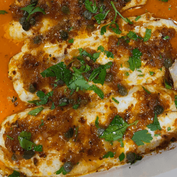 Spicy Lemon Sea Trout in White Casserole pan with paprika lemon caper sauce