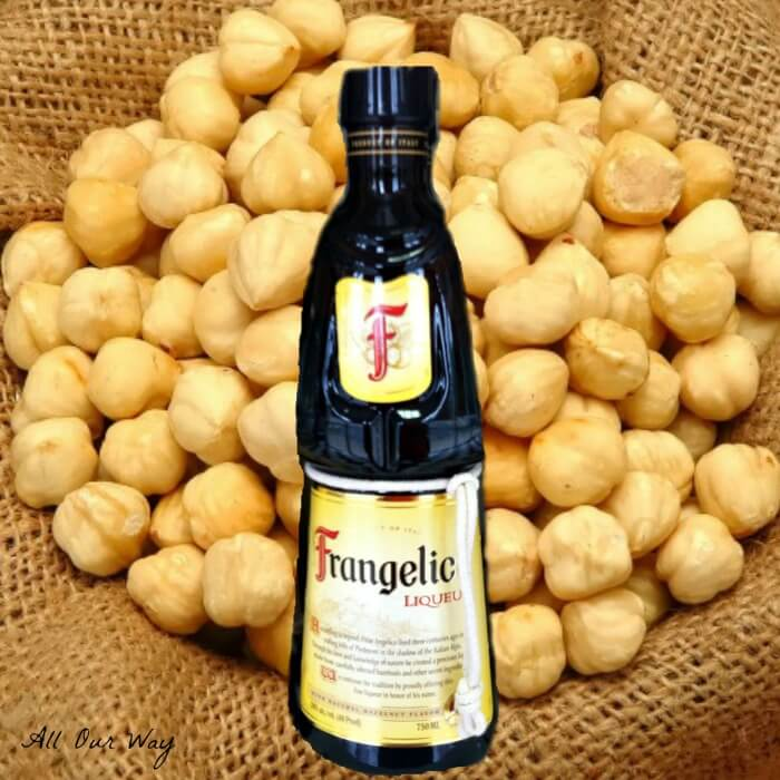 Frangelico a hazelnut and herb Liqueur with hazelnuts in background on burlap. @allourway.com