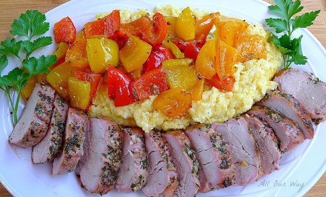 Grilled whole pork tenderloin with colored peppers over polenta @ allourway.com