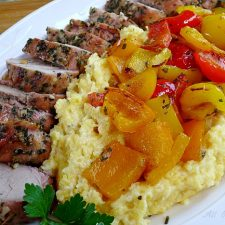Grilled pork tenderloin with colored peppers over polenta @ allourway.com