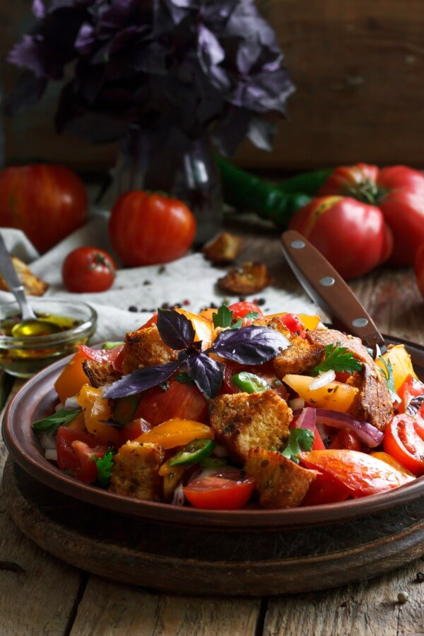 Panzanella Salad is a popular Italian salad that uses stale bread as a base to soak up the delicious juices form the vegetables in the Tuscan salad. It's an easy salad to make ahead and then simply add the wine vinegar vinaigrette to it. A family favorite and a great potluck salad, picnic salad, or a large gathering. #panzanella , #panzanellasaladrecipe, Tuscansalad, #stalebreadsalad, #potlucksalad, #allourway