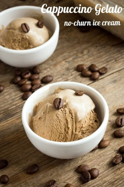 Two white bowls with cappuccino ice cream on a rustic wooden table and coffee beans strewn around the bowl.