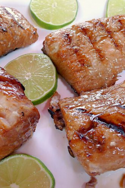 Lime marinated Mahi Mahi fillets on platter with lime slices