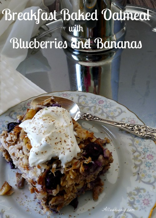 Breakfast Baked Oatmeal with Blueberries and Bananas on a flowered china plate with a silver spoon. A dollop of whipped cream on top @allourway.com