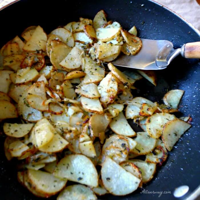 Skillet Fried Italian Herbed Potatoes sautéed in skillet and seasoned with fresh herbs @allourway.com