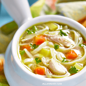 Chicken Noodle Soup with Carrots and Celery in White Bowl